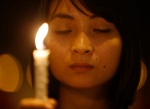 A woman holds a candle as she takes part in a candlelight vigil held by Malaysian ethnic Chinese for the passengers of Malaysia Airlines MH370 near Independence Square in Kuala Lumpur March 10, 2014.