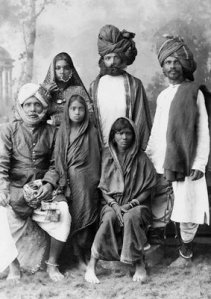 Family group of Thugees  (Robbers). The Indian thugs kill people by strangling them with their long kerchiefs which they carry on their shoulders.
