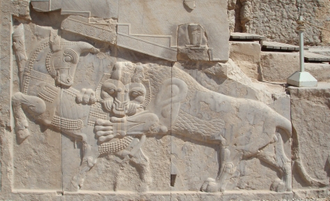 Bas-relief in Persepolis, Fars province of Iran. A Zoroastrian symbol of Nowruz – on the vernal equinox the powers of the eternally fighting bull (personifying the Earth) and lion (personifying the Sun) are equal.  (Licence Wikipedia)